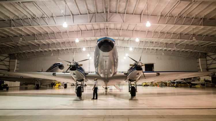 gray plane inside hangar